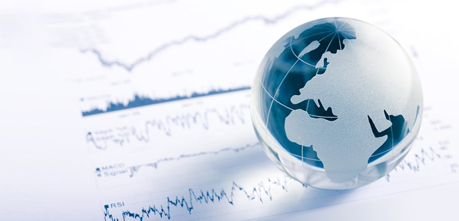 Glass Globe Resting On A Stock Chart