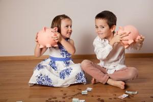 Children Holding Their Piggy Bank 300x200