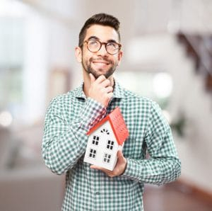man holding a house