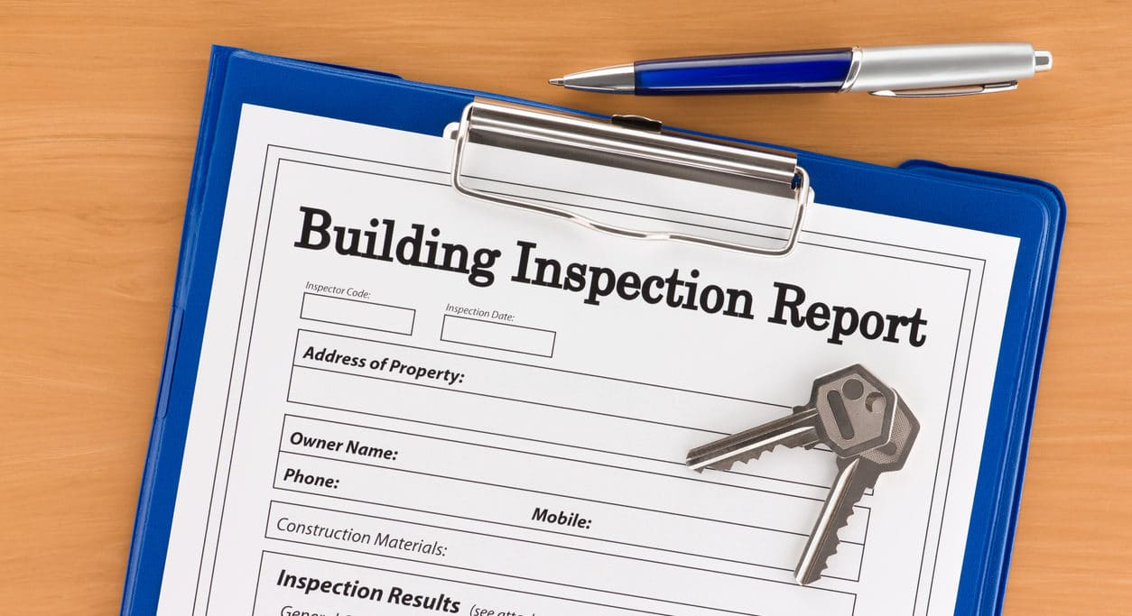 Building Inspection Report with Pen and Keys