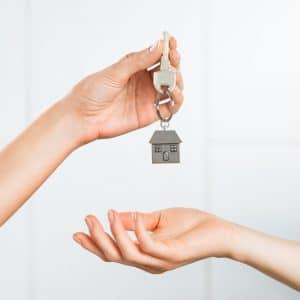 Woman receiving house key