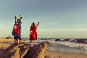 Boy And Girl Dressed As Superheroes On California Beach 300x200