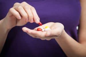 Girl Takes Antibiotics