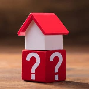 House Model On Red Block With Question Mark Symbols
